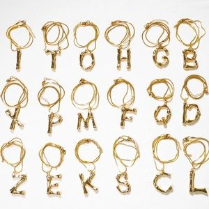 Any 2  $27 Gold P  Initial Bamboo Necklaces